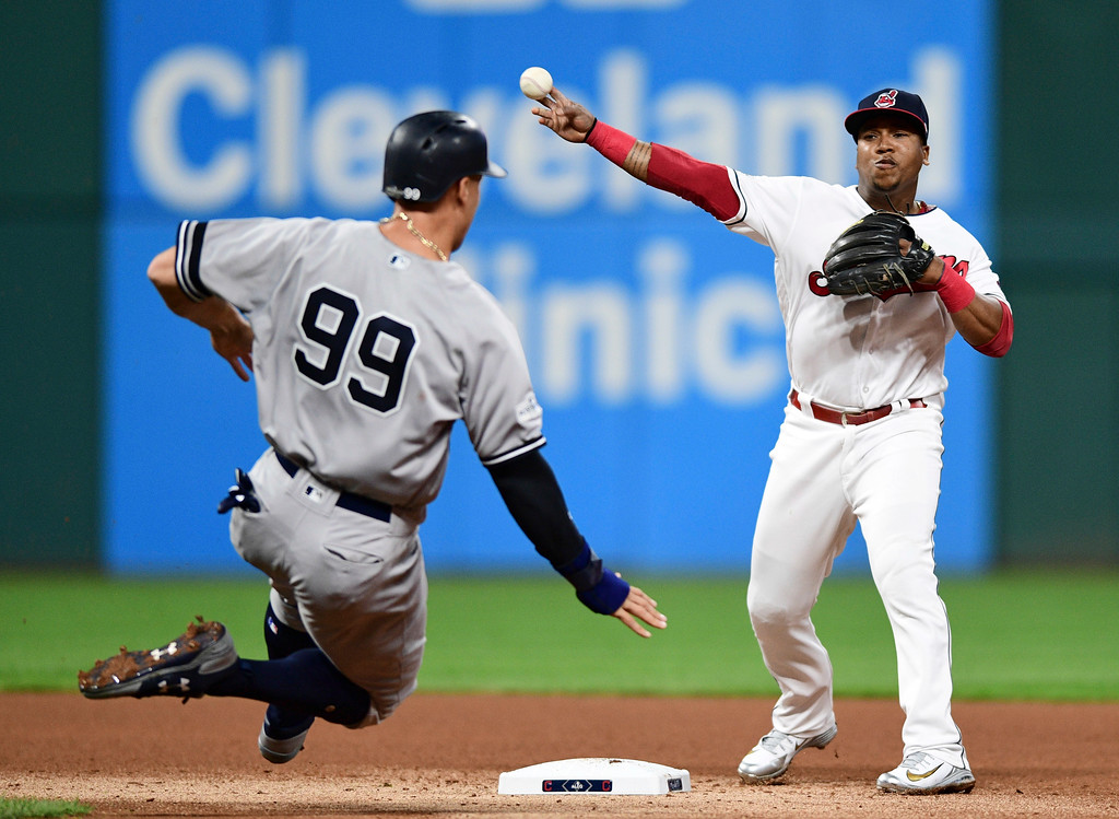 . Cleveland Indians\' Jose Ramirez throws to first base after forcing out New York Yankees\' Aaron Judge during the fourth inning of Game 1 of a baseball American League Division Series, Thursday, Oct. 5, 2017, in Cleveland. Gary Sanchez was out at first base for the double play. (AP Photo/David Dermer)