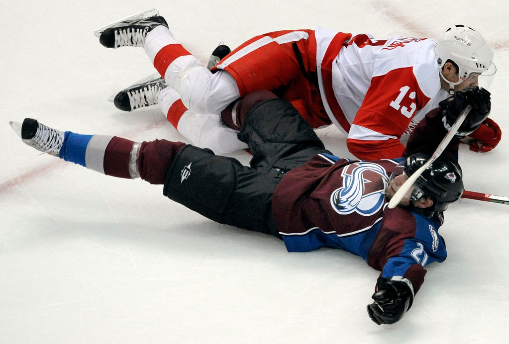 . Detroit center Pavel Datsyuk (13) took down Peter Forsberg in the third period.  The Colorado Avalanche lost to the Detroit Red Wings 5-3 at the Pepsi Center, Tuesday night, April 29, 2008 in Game 3 of the Western Conference semifinals of the NHL Stanley Cup playoffs.      Karl Gehring/The Denver Post