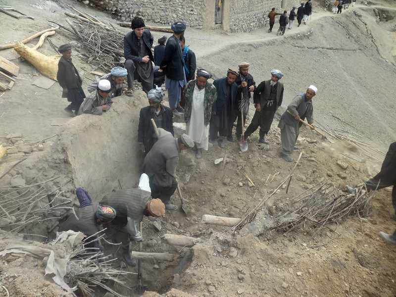 . Afghans search for survivors buried after Friday\'s landslide in Abi-Barik village in Badakhshan province, northeastern Afghanistan, Saturday, May 3, 2014. Afghan rescuers and hundreds of volunteers armed with shovels rushed on Saturday to help villagers hit by a massive landslide in the remote northeast a day earlier, officials said, while fears of a new torrent of mud and earth complicated rescue efforts. (AP Photo/Sayed Ibrahim)