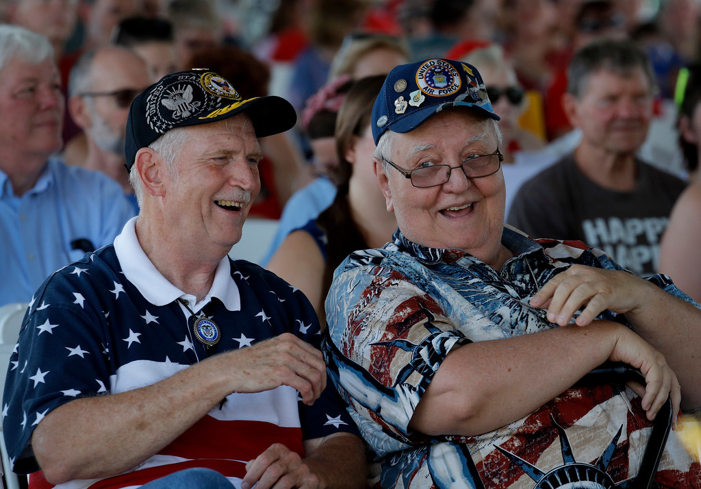 . Don Wood, left, from Overland Park, Kan. and Don Ross, from Kansas City, Kan., listen to an Independence Day concert by the American Legion Band of Greater Kansas City Wednesday, July 4, 2018, in Merriam, Kan. Cleveland won 6-4. (AP Photo/Charlie Riedel)