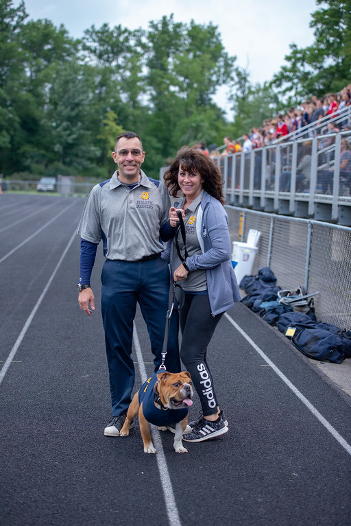 . Aimee Bielozer - The Morning Journal<br> Olmsted Falls mascot Scrappy Coa-Coa led the Bulldogs onto the field against Westlake on Sept. 7.