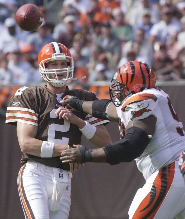 . News-Herald file Browns\' quarterback Tim Couch gets of a pass under pressure from Bengal\'s defensive tackle Oliver Gibson duringg the first half of yesterday\'s Browns loss at Cleveland Browns Stadium.