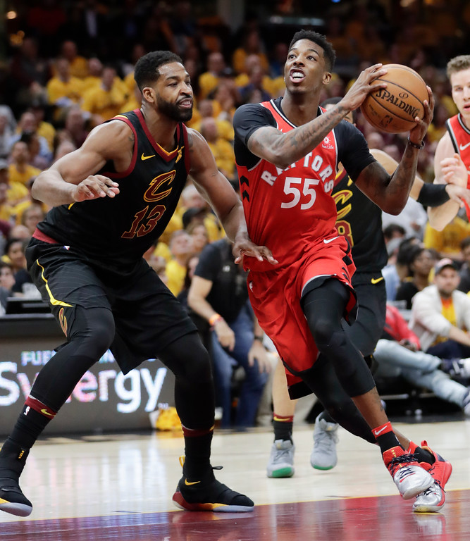 . Toronto Raptors\' Delon Wright (55) drives on Cleveland Cavaliers\' Tristan Thompson (13) in the second half of Game 4 of an NBA basketball second-round playoff series, Monday, May 7, 2018, in Cleveland. (AP Photo/Tony Dejak)