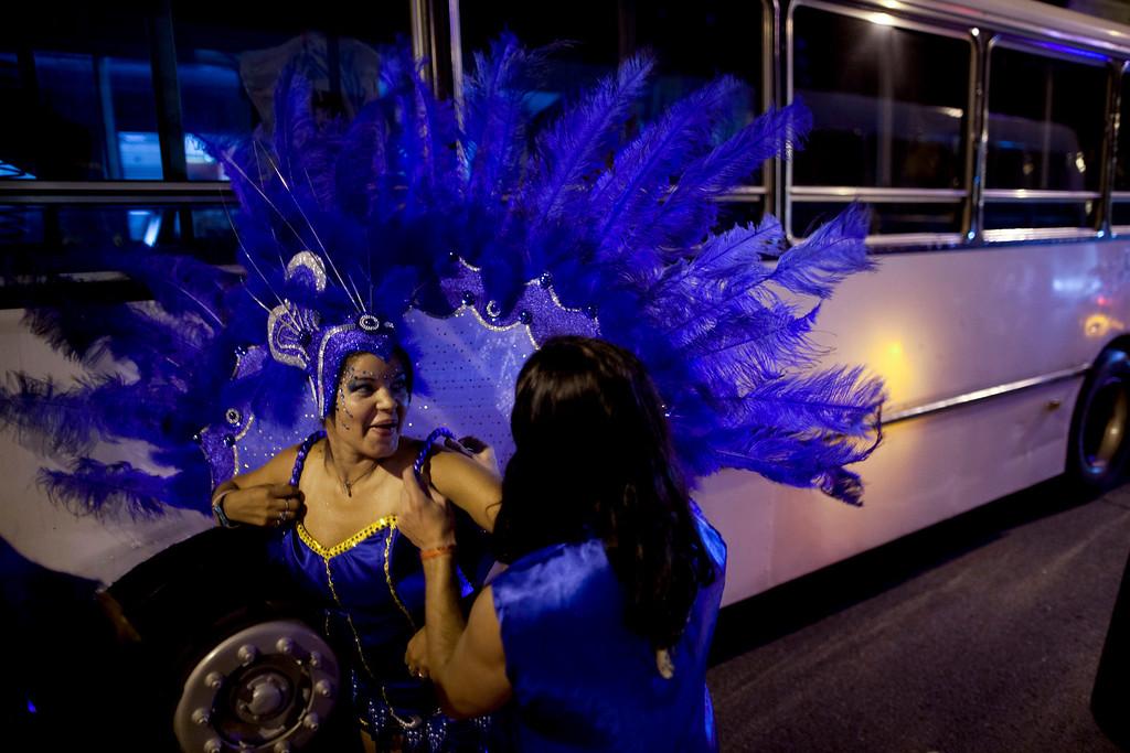 ". Members of the murga \""Los amantes de La Boca\"" prepare before participating in carnival celebrations in Buenos Aires, Argentina, Saturday, Feb. 2, 2013. (AP Photo/Natacha Pisarenko)"
