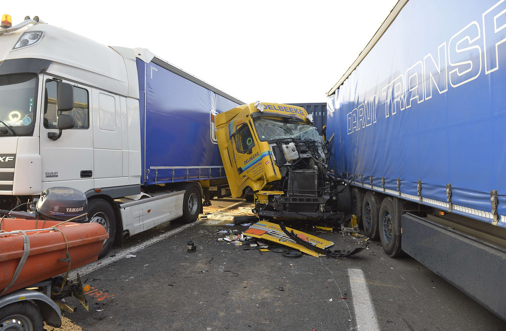 . A picture shows wrecked trucks at the site of a multiple collision accident on highway A19 towards Kortrijk near Zonnebeke-Beselare on December 3, 2013. AFP PHOTO/BELGA/ERIC LALMAND/AFP/Getty Images