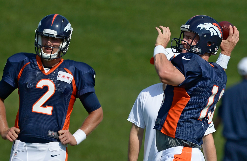 . Denver Broncos quarterback Peyton Manning (18) throws a pass during drills on day five of the Denver Broncos 2014 training camp July 28, 2014 at Dove Valley. (Photo by John Leyba/The Denver Post)