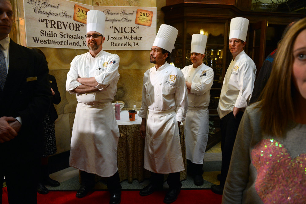 . DENVER, CO. - JANUARY 25:  (l-r) Executive Chef William Dexter and staff, Michael Rodriguez, Michael Wright and Nick Maloney wait to view the National Western Stock Show\'s Grand Champion and Reserve Steers at the Brown Palace Hotel & Spa in Denver, CO, January, 25, 2013. The Grand Champion ,Trevor, weighing in at 1335 lbs. was raised by Shilo Schaake of Westmoreland, KS. The Reserve Grand Champion, Nick, 1275 lbs, was shown by  Jessica Webster of Runnells, IA. The skittish champions were also joined by a third steer, Willie, raised by Lauren May, of Mineral Point, WI, for moral support. (Photo By Craig F. Walker / The Denver Post)