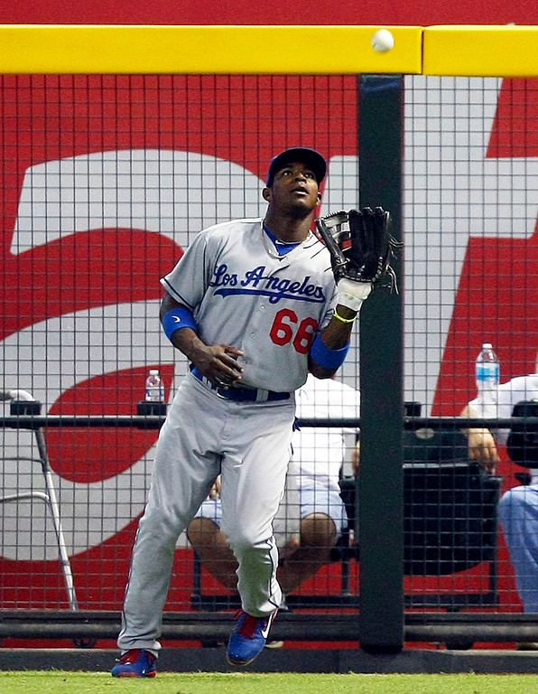 . Los Angeles Dodgers right fielder Yasiel Puig (66) makes the catch in the first inning during a baseball game against the Arizona Diamondbacks on Monday, July 8, 2013, in Phoenix. (AP Photo/Rick Scuteri)
