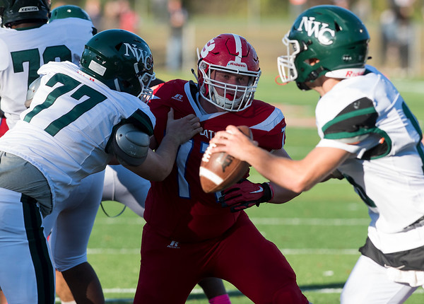 10/04/19 Wesley Bunnell | StaffrrBerlin football defeated NW Catholic on Friday afternoon at Sage Park. Jake Holmes (77) eyes the NWC quarterback.