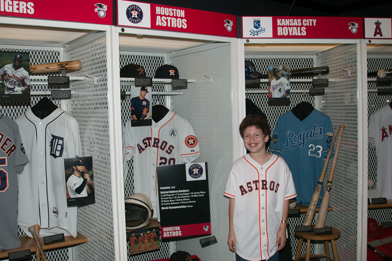 Rafael in front of  Astros locker -- A trip to the Baseball Hall of Fame, Cooperstown, NY, June 2014