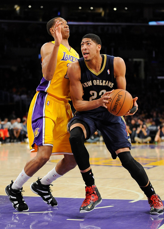. New Orleans Pelicans forward Anthony Davis (23) works against Los Angeles Lakers forward Wesley Johnson, left, during the first half of an NBA basketball game, Tuesday, March 4, 2014, in Los Angeles.(AP Photo/Gus Ruelas)