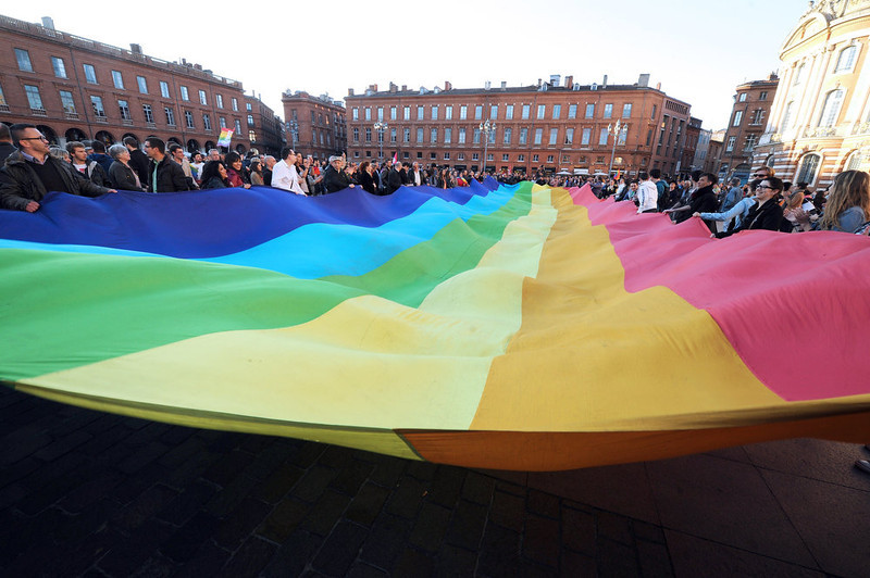 . People celebrate and deploy a rainbow banner on April 23, 2013 on Capitole square in Toulouse, south western France after the French national assembly adopted a bill legalizing same-sex marriages and adoption for gay couples, defying months of opposition protests. In its second and final reading, a majority of lawmakers approved the bill by a vote of 331 to 225. ERIC CABANIS/AFP/Getty Images