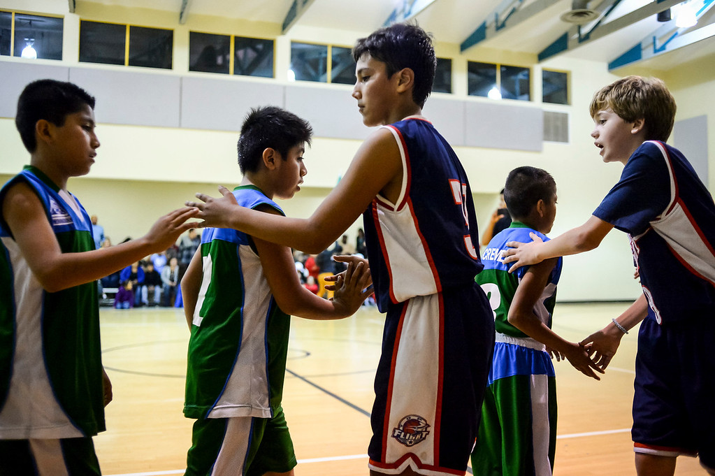 """. Triqui kids basketball team, from the mountainous region of Oaxaca, Mexico, who have been called the \""""Barefoot Champions of the Mountain,\"""" are known throughout their native Mexico for playing basketball without shoes took on the local Top Flight boys team at the Pacific Boys Lodge in Woodland Hills, CA Wednesday, December 18, 2013.  Here the Triqui team and the Top Flight team greet each other after the game.   (Photo by David Crane/Los Angeles Daily News)"""