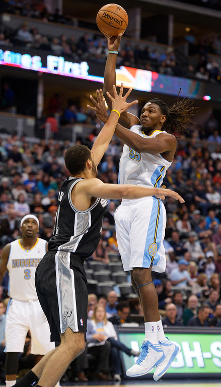. DENVER, CO - OCTOBER 14: Denver Nuggets small forward Kenneth Faried (35) takes a shot over San Antonio Spurs power forward Jeff Ayres (11) October 14, 2013 as the Denver Nuggets defeat the San Antonio Spurs 98-94 at Pepsi Center. (Photo By John Leyba/The Denver Post)