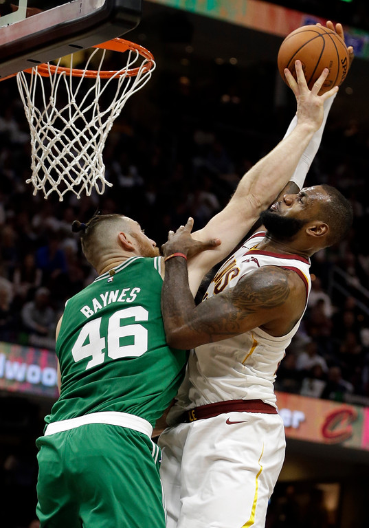 . Boston Celtics\' Aron Baynes (46), from Australia, fouls Cleveland Cavaliers\' LeBron James (23) in the second half of an NBA basketball game, Tuesday, Oct. 17, 2017, in Cleveland. The Cavaliers won 102-99. (AP Photo/Tony Dejak)