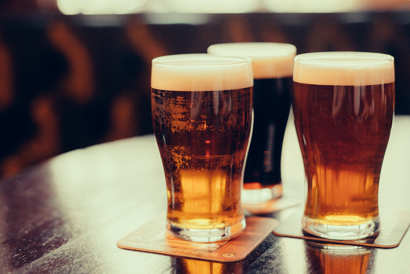 Glasses of light and dark beer. Editorial credit: Viiviien / Shutterstock.com