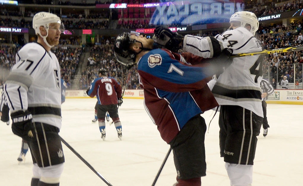 . DENVER, CO - FEBRUARY 18: Colorado Avalanche center John Mitchell (7) gets a glove in the face by Los Angeles Kings defenseman Robyn Regehr (44) during the third period February 18, 2015 at Pepsi Center. (Photo By John Leyba/The Denver Post)