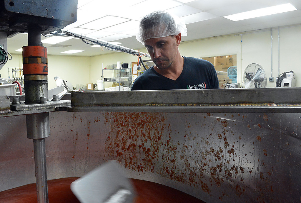 . David Saverino checks the cooking process for his marinara sauce at Da\'Kine Foods in Newport Beach shortly before the bottling process. Following the successful launch of Saverino\'s Italian Deli and Market in Redlands nearly two years ago, David Saverino is bottling the flavor of his business with the introduction of four separate sauces. In addition to selling the sauces at his deli, Saverino hopes to see his product on the shelves of local markets. (Photo by Rick Sforza/Redlands Daily Facts)