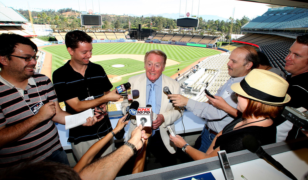 . Hall of Fame broadcaster Vin Scully announced that he will return for a 62nd season with the Los Angeles Dodgers to broadcast both home and western division games before a Major League baseball game between the Cincinnati Reds and the Los Angeles Dodgers at Dodger Stadium on Sunday, August 22, 2010, in Los Angeles. (SGVN/Staff Photo by Keith Birmingham/SPORTS)