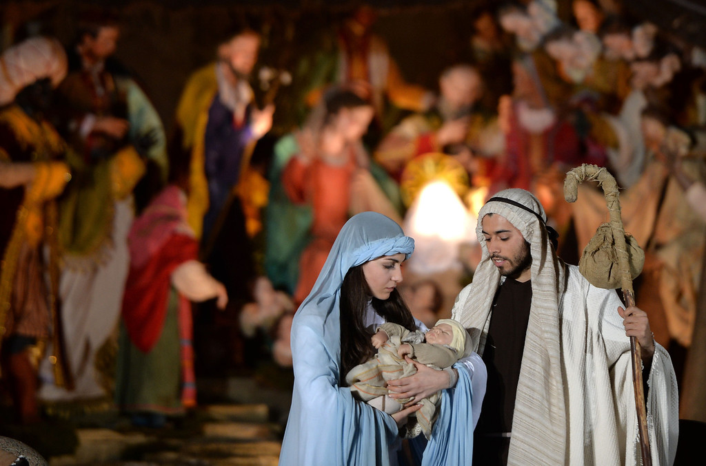 . People play a nativity scene during the unveiling ceremony of the crib in St Peter\'s Square at the Vatican, on December 24, 2013. Pope Francis visited his predecessor Benedict XVI yesterday for an informal Christmas greeting, as the Argentine pontiff prepares to celebrate his first Christmas as leader of the world\'s Roman Catholics.   FILIPPO MONTEFORTE/AFP/Getty Images