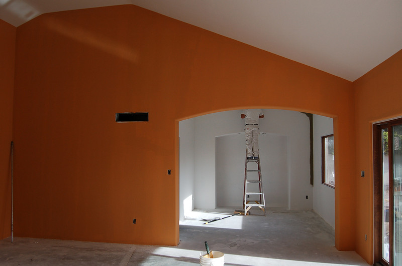 The contrast between the living room and dining room will be great; now it's just stark white, but it will be dark green.