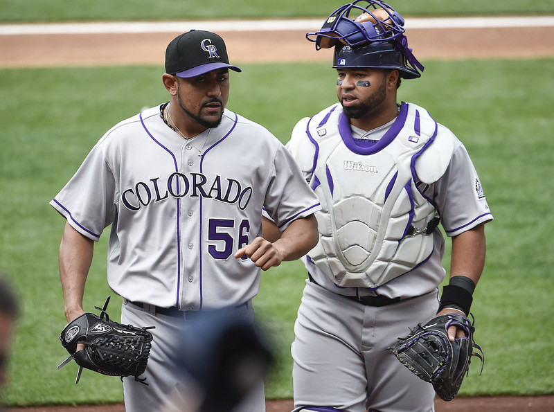. Franklin Morales #56 of the Colorado Rockies, left, talks with Wilin Rosario #20 as he comes off the field a during the second inning of a  baseball game against the San Diego Padres at Petco Park April 17, 2014 in San Diego, California.  (Photo by Denis Poroy/Getty Images)