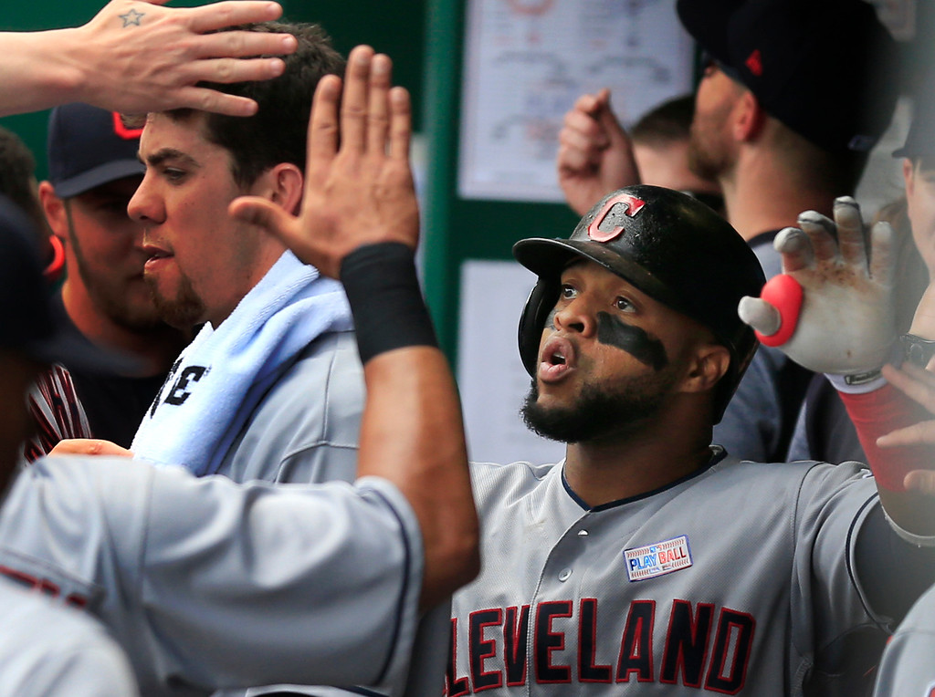 . Cleveland Indians\' Carlos Santana is congratulated by teammates after a solo home run off Kansas City Royals starting pitcher Jason Hammel during the second inning of a baseball game at Kauffman Stadium in Kansas City, Mo., Saturday, June 3, 2017. (AP Photo/Orlin Wagner)