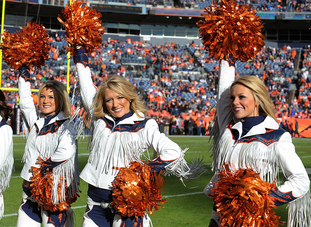 Description of . DENVER - Denver Broncos cheerleaders during the pregame activities before the game against Kansas City Sunday at Sports Authority Field. Steve Nehf, The Denver Post