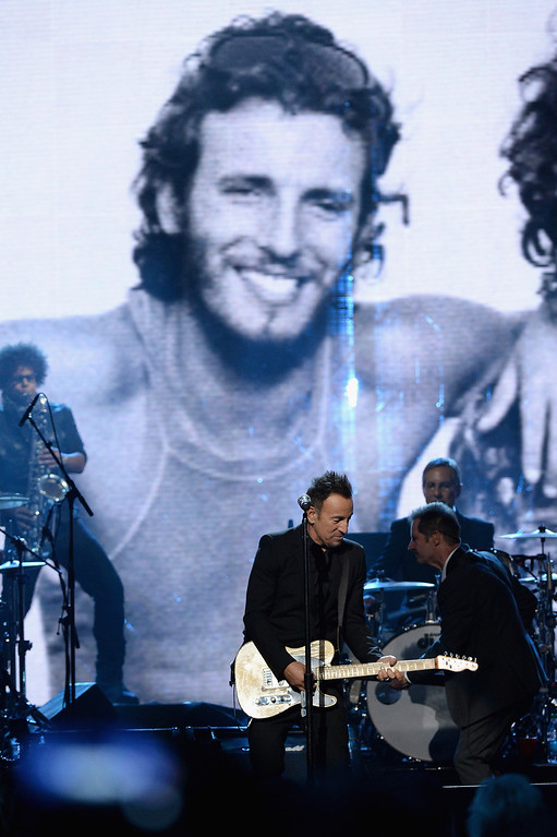 . NEW YORK, NY - APRIL 10: (L-R) Musician Bruce Springsteenperforms onstage with Garry Tallent and Max Weinberg of the E Street Band at the 29th Annual Rock And Roll Hall Of Fame Induction Ceremony at Barclays Center of Brooklyn on April 10, 2014 in New York City.  (Photo by Larry Busacca/Getty Images)