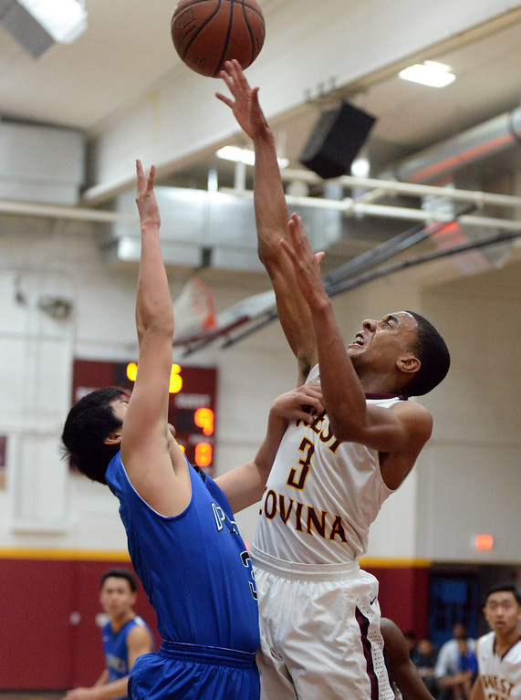 . West Covina\'s Darrion Chavers (3) shoots against Diamond Ranch in the first half of a prep basketball game at West Covina High School in West Covina, Calif., on Wednesday, Jan. 8, 2014. (Keith Birmingham Pasadena Star-News)