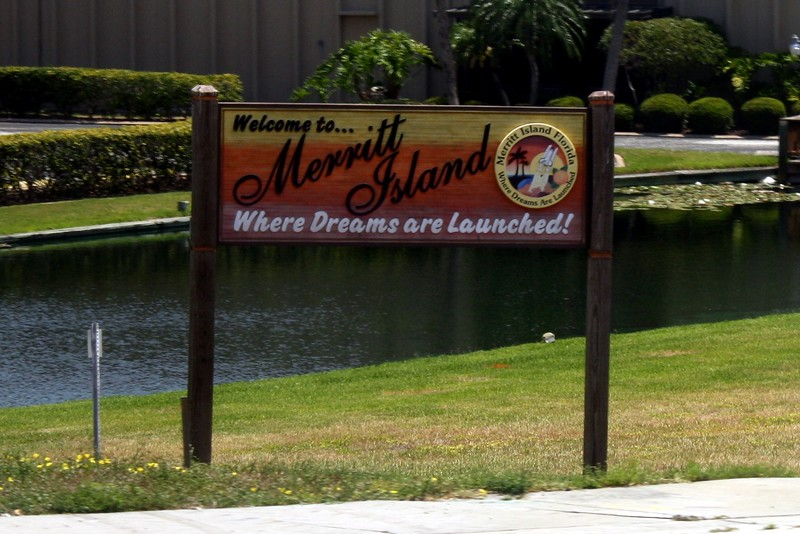Welcome sign for Exit sign for Merritt Island, home of the Kennedy Space Center