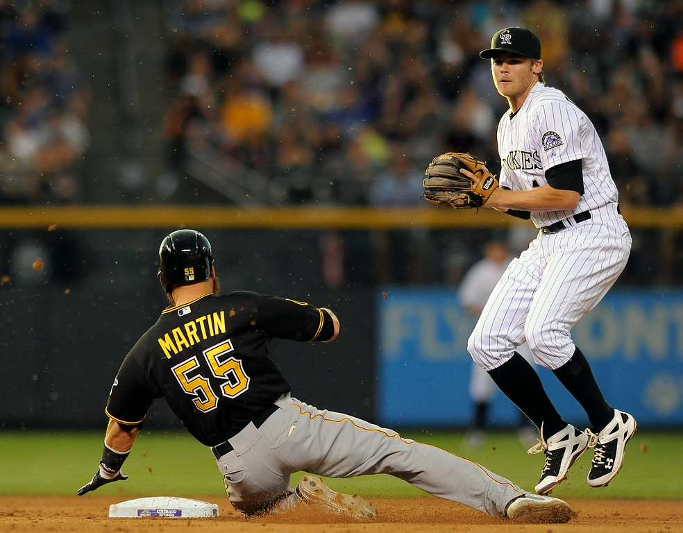 . Pittsburgh Pirates Russell Martin (55) slides safely into second base past Colorado Rockies second baseman DJ LeMahieu to avert a triple play in the fifth inning of a baseball game on Friday, July 25, 2014, in Denver. (AP Photo/Chris Schneider)