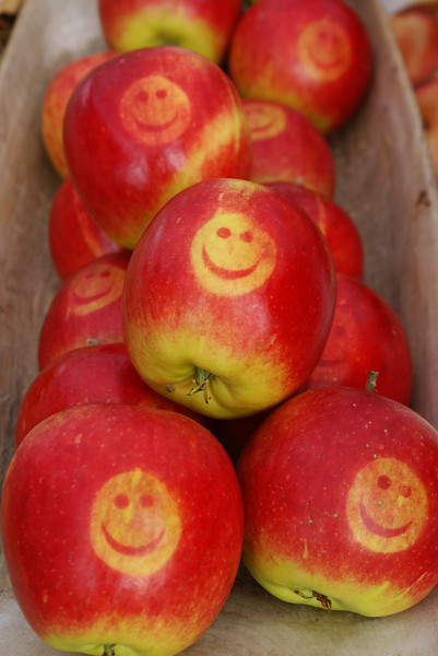 Some happy apples from a street market.