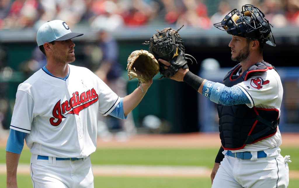 . Cleveland Indians\' Yan Gomes, right, congratulates starting pitcher Shane Bieber after Bieber pitched in the first inning of a baseball game against the Minnesota Twins, Sunday, June 17, 2018, in Cleveland. (AP Photo/Tony Dejak)