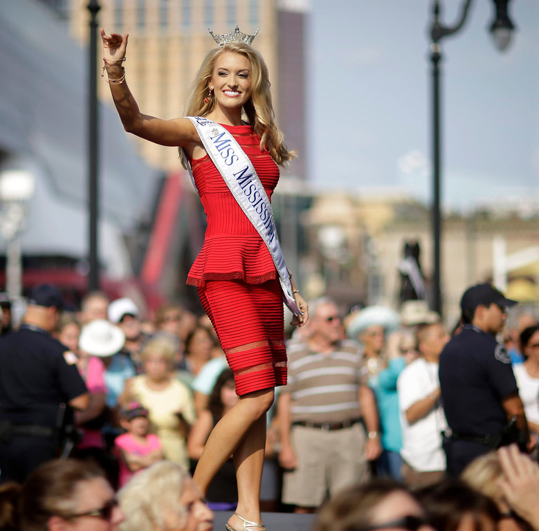 . Miss Mississippi Chelsea Rick waves as she walks on a runway as Miss America contestants arrive in Atlantic City, N.J. on Tuesday, Sept. 3, 2013. The Miss America pageant is back in the city where it began, six years after spurning the city for Las Vegas. The pageant held a welcoming ceremony Tuesday for the 53 contestants, one from each state plus the District of Columbia, Puerto Rico and the U.S. Virgin n Islands. The contestants filed out of Boardwalk Hall, where the competition will begin next week and culminate days later, and walked across the Boardwalk to a stage. (AP Photo/Mel Evans)