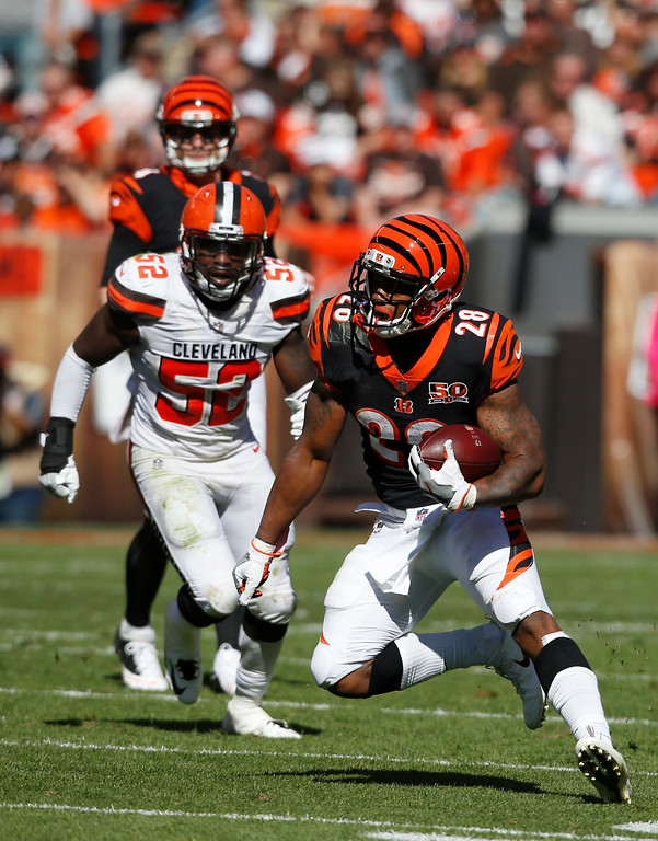. Cincinnati Bengals running back Joe Mixon (28) runs the ball in the second half of an NFL football game against the Cleveland Browns, Sunday, Oct. 1, 2017, in Cleveland. (AP Photo/Ron Schwane)