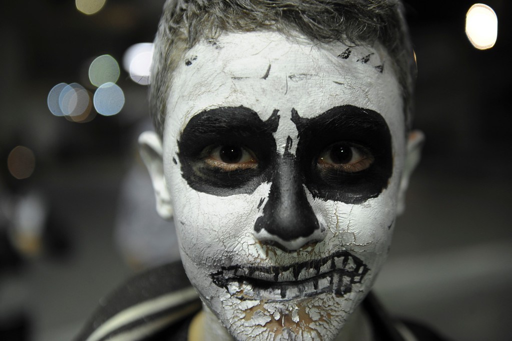 . A child with make-up  participates in an annual Halloween party in central Pristina, on October 31, 2013 AFP PHOTO / ARMEND NIMANI/AFP/Getty Images