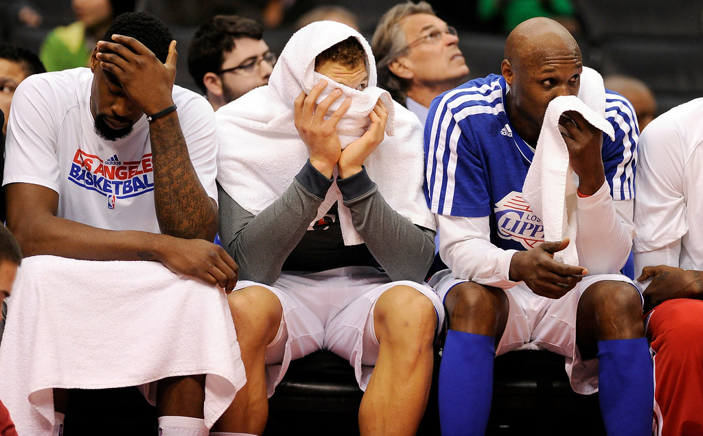 . Clippers\' DeAndre Jordan #6, Blake Griffin #32 and Lamar Odom #7 hang their heads on the bench during their game at the Staples Center in Los Angeles Friday, February  21, 2013. The Spurs beat the Clippers 116-90. (Hans Gutknecht/Staff Photographer)