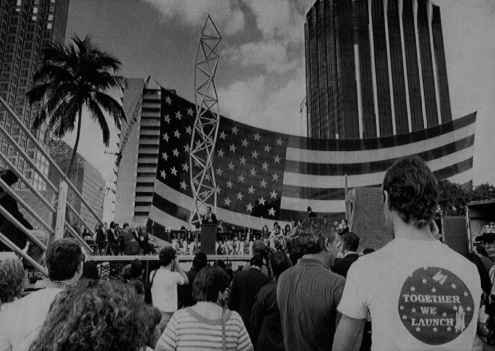"""Description of . Congressmen Bill Nelson speaks to a crowd of about 100 people during the official dedication of the \""""Challenger 7 Miami Memorial\""""  at Chopin Plaza at Bayfront Park in Miami. Saturday is third anniversary of the explosion of the Space Shuttle Challenger that claimed the lives of seven astronauts. Denver Post Library Archive"""