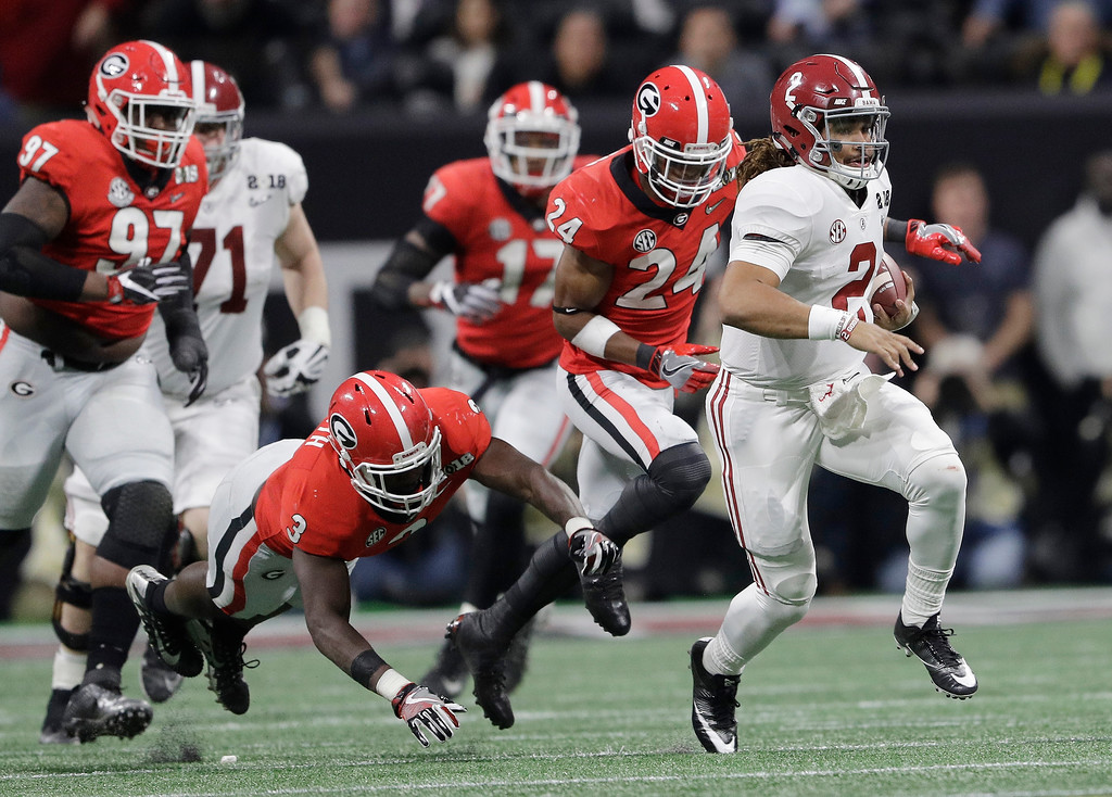 . Alabama quarterback Jalen Hurts runs for a first down during the first half of the NCAA college football playoff championship game against Georgia Monday, Jan. 8, 2018, in Atlanta. (AP Photo/David J. Phillip)
