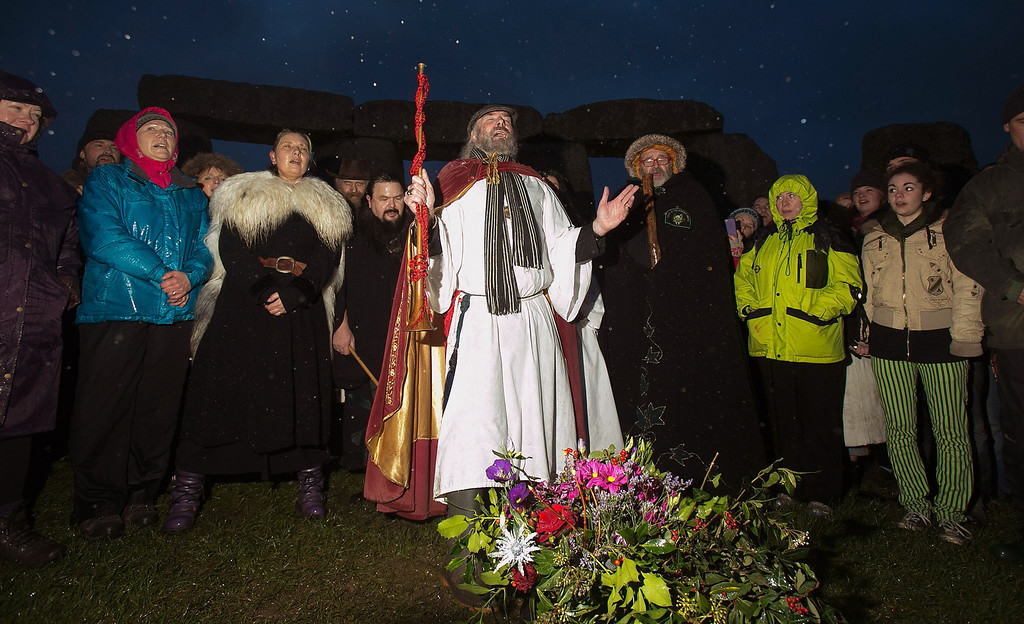 . Rollo Maughfling, Archdruid of Stonehenge & Britain, (centre) conducts a ceremony as druids, pagans and revelers gather, hoping to see the sun rise as they take part in a winter solstice ceremony at Stonehenge on December 21, 2013 in Wiltshire, England.  (Photo by Matt Cardy/Getty Images)