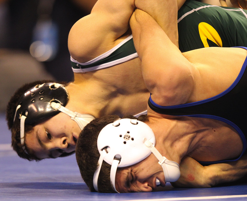 . Live Oak\'s Isaiah Locsin, top, wrestles North Torrance\'s Jordan Gurrola in a 120-pound fifth round match during the California Interscholastic Federation wrestling championships in Bakersfield, Calif., on Saturday, March 2, 2013. Locsin would go onto win the match and qualify for the finals. (Anda Chu/Staff)