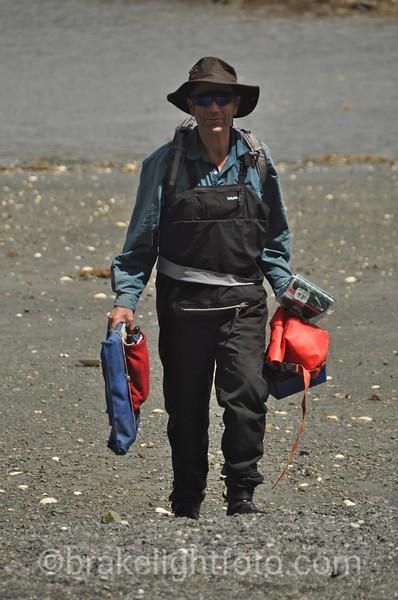 Carry gear up the beach on Spring Island