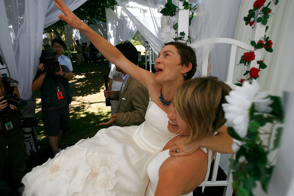 . WEST HOLLYWOOD, CA - JUNE 17:  Tori (L) and Kate Kendall, who already share the same last name and have a five-month-old baby, celebrate after being joined in wedlock as the era of same-sex marriage begins in California, June 17, 2008 in West Hollywood, California. Conservative and religious groups hope that voters will support their initiative on the November ballot to alter the state constitution to permanently ban gay marriages. Meanwhile, many business owners are looking for a wedding related sales boom. A study released by University of California Los Angeles (UCLA) this month projects that nearly half of the state\'s 102,600 same-sex couples will marry in the next three years and, along with same-sex couples from other states, will spend more than $683 million on weddings, honeymoons and other marriage-related activities.  (Photo by David McNew/Getty Images)