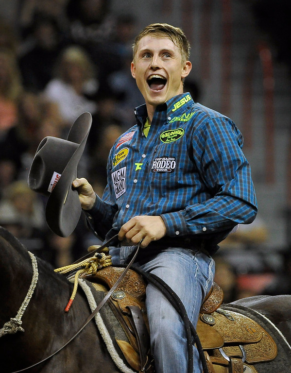 . Tuf Cooper of Decatur, Texas reacts after competing in the tie-down roping during the third go-round of the Wrangler National Finals Rodeo on Saturday, Dec. 6, 2014, in Las Vegas. (AP Photo/Las Vegas Review Journal, David Becker)