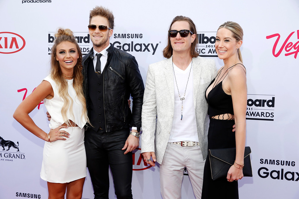 . Brittney-Marie Cole, from left, Brian Kelley and Tyler Hubbard of the musical group Florida Georgia Line, and Hayley Stommel arrive at the Billboard Music Awards at the MGM Grand Garden Arena on Sunday, May 17, 2015, in Las Vegas. (Photo by Eric Jamison/Invision/AP)
