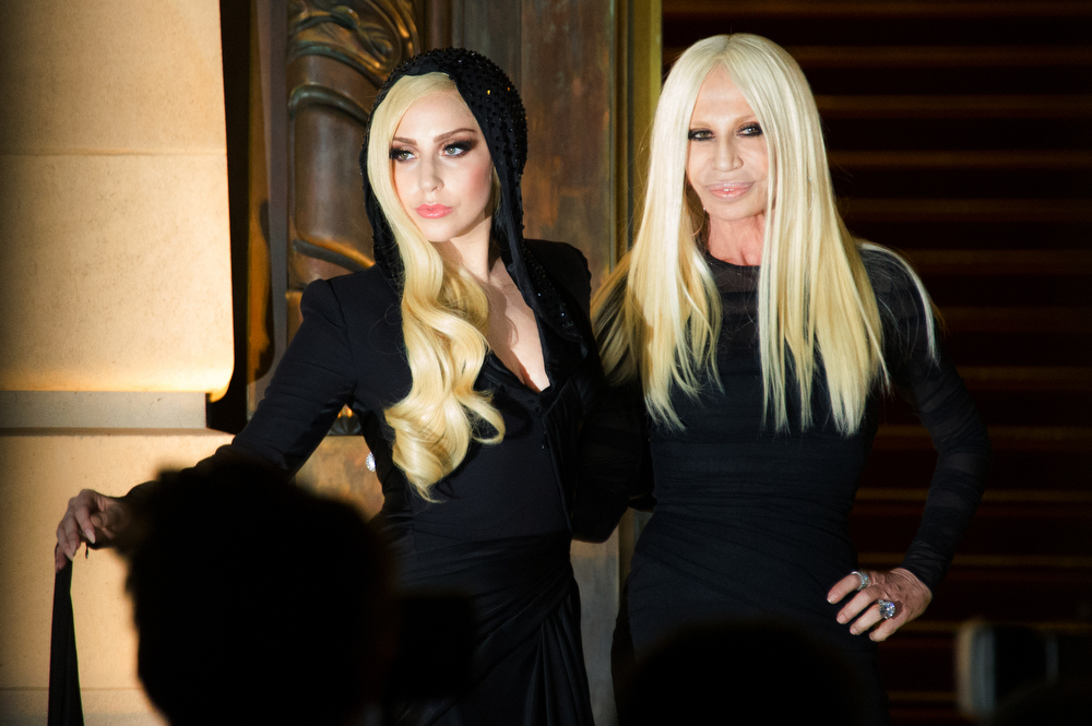 . Lady Gaga, left, and fashion designer Donatella Versace arrive to the attend Atelier Versace Spring-Summer 2014 Haute Couture fashion collection, presented Sunday, Jan. 19, 2014 in Paris. (AP Photo/Zacharie Scheurer)