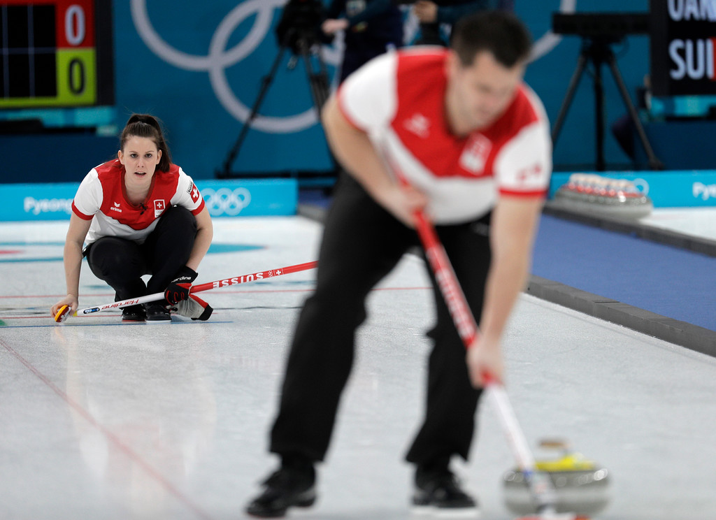 . Switzerland Jenny Perret, left, and Martin Rios during their mixed doubles curling semi-final match against Russian athletes at the 2018 Winter Olympics in Gangneung, South Korea, Monday, Feb. 12, 2018. (AP Photo/Aaron Favila)