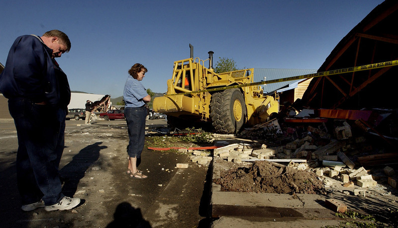 . (l-r) Casey and Rhonda Farrell owners of Gambles of Grand County survey the damage to their business on Highway 40 in Granby, CO. The shop was destroyed when a fortified bulldozer  driven by Marvin Heemeyer plowed into it. Heemeyer drove a fortified bulldozer through the streets of Granby Friday destroying a number of buildings.   (DENVER POST PHOTO BY CRAIG F. WALKER)