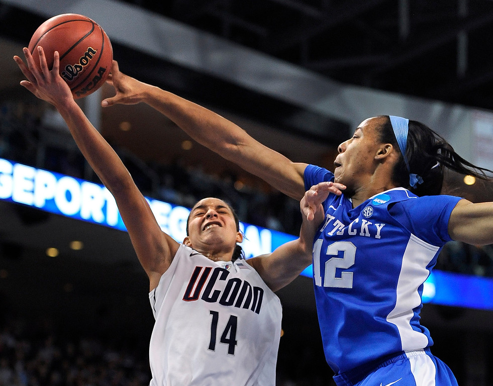 . Kentucky\'s Jelleah Sidney, right, stops a shot attempt by Connecticut\'s Bria Hartley, left, during the second half of a regional final game in the NCAA college basketball tournament in Bridgeport, Conn., Monday, April 1, 2013. (AP Photo/Jessica Hill)
